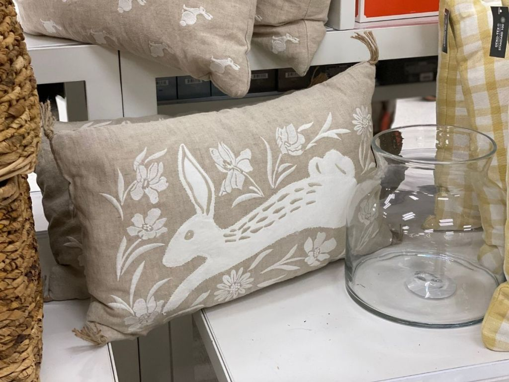 tan rectangle pillow with white bunny and tassels