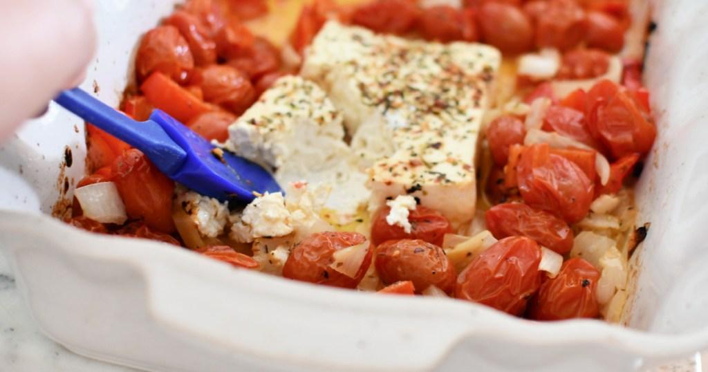 stirring melted feta for tiktok pasta