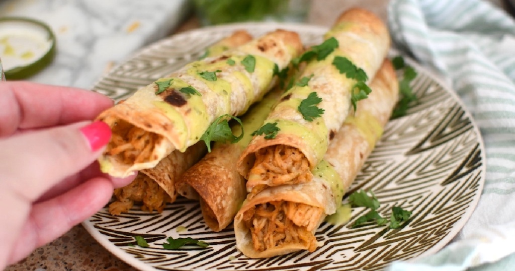 taquitos filled with shredded chicken on plate