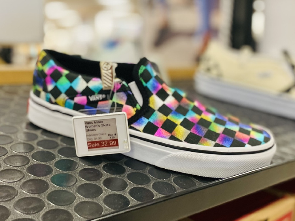 checkered colorful slip on shoes on store display
