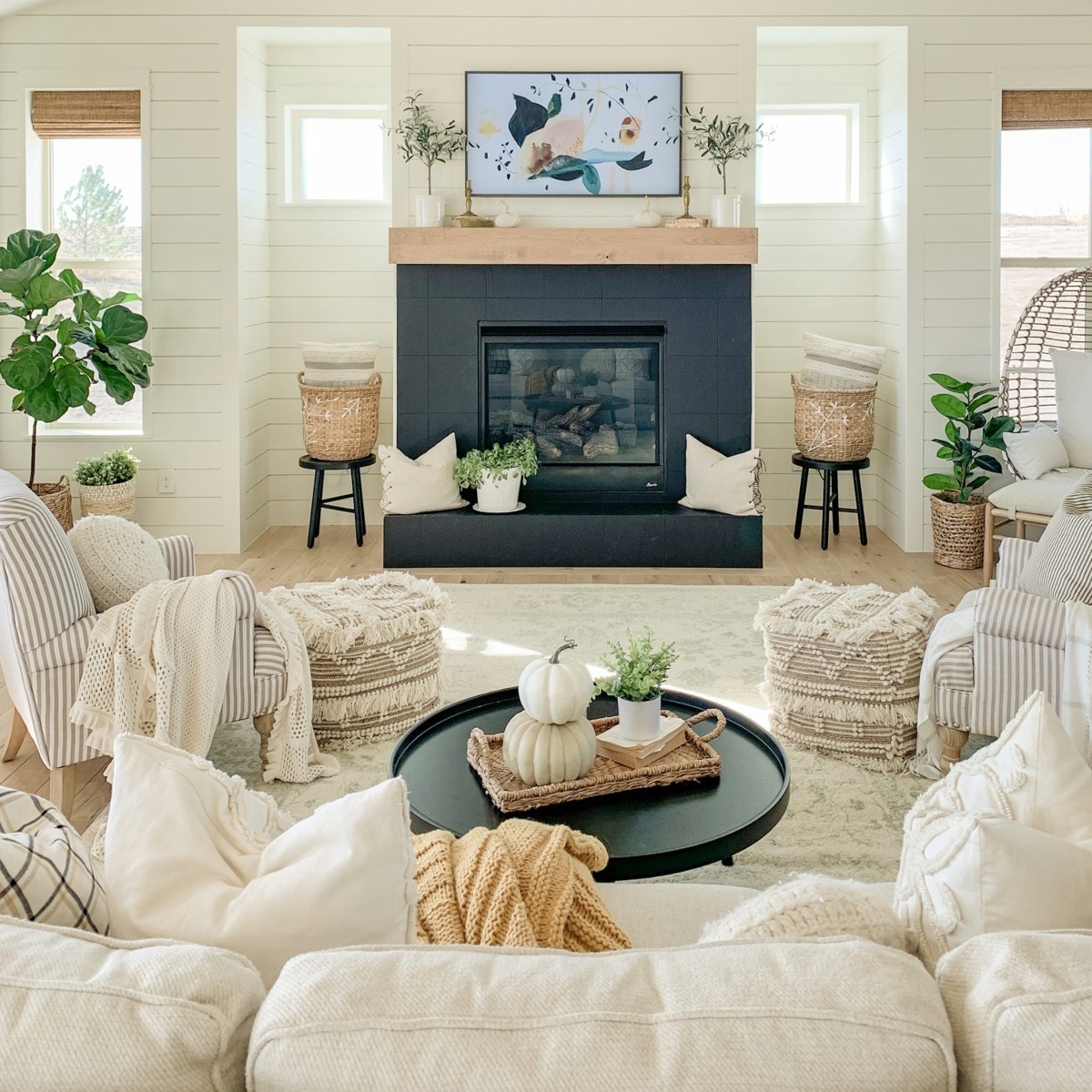 living room with navy fireplace and neutral President's Day furniture sale items