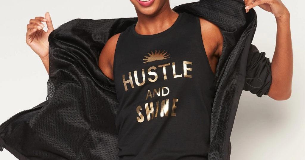 woman wearing a hustle and shine active top