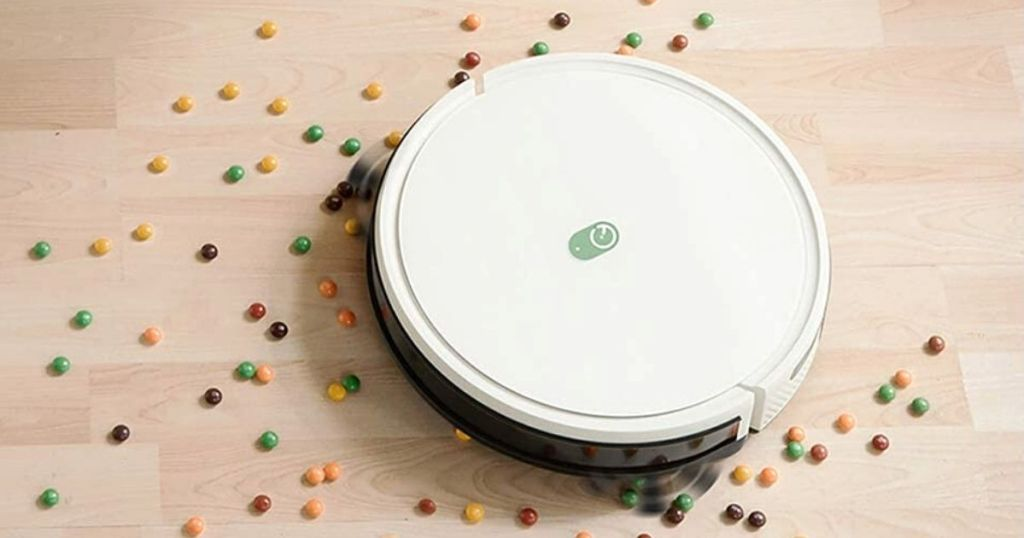 Yeeti robot vacuum cleaning up candy