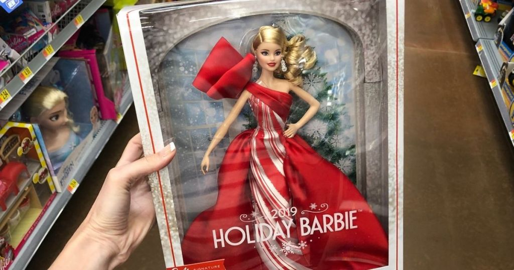 hand holding 2019 Holiday Barbie in store