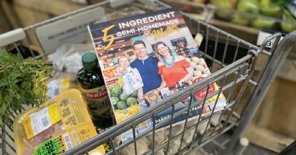 5 Ingredient Meals Cookbook in cart full of groceries