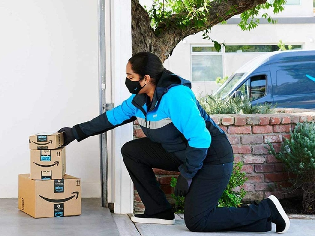 amazon delivery putting packages inside a garage