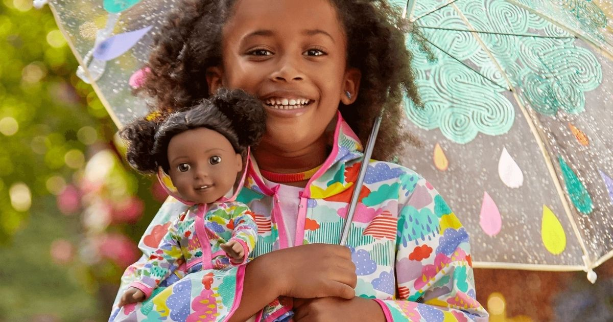 girl and doll in American Girl Pink & Green Rainy Day Slickers with umbrella