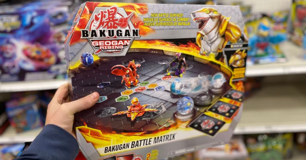 hand holding toy battle arena