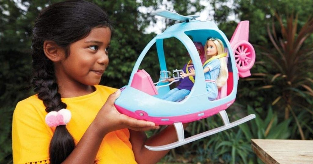 girl with Barbie Adventures Helicopter
