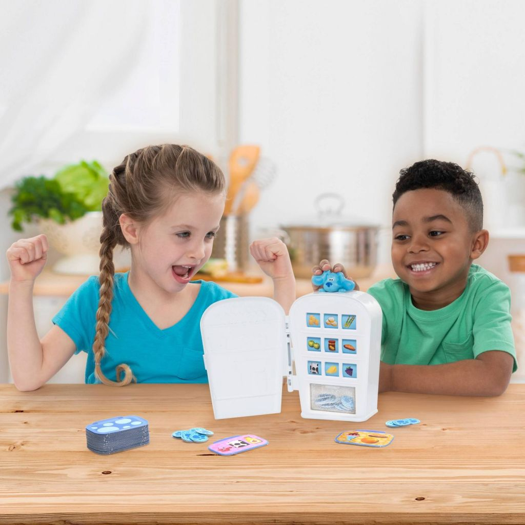 two kids playing a board game called Blue's Snack Match Game