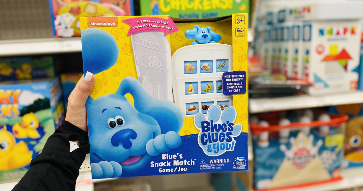 Hand holding up Blue's Snack Match gamebox