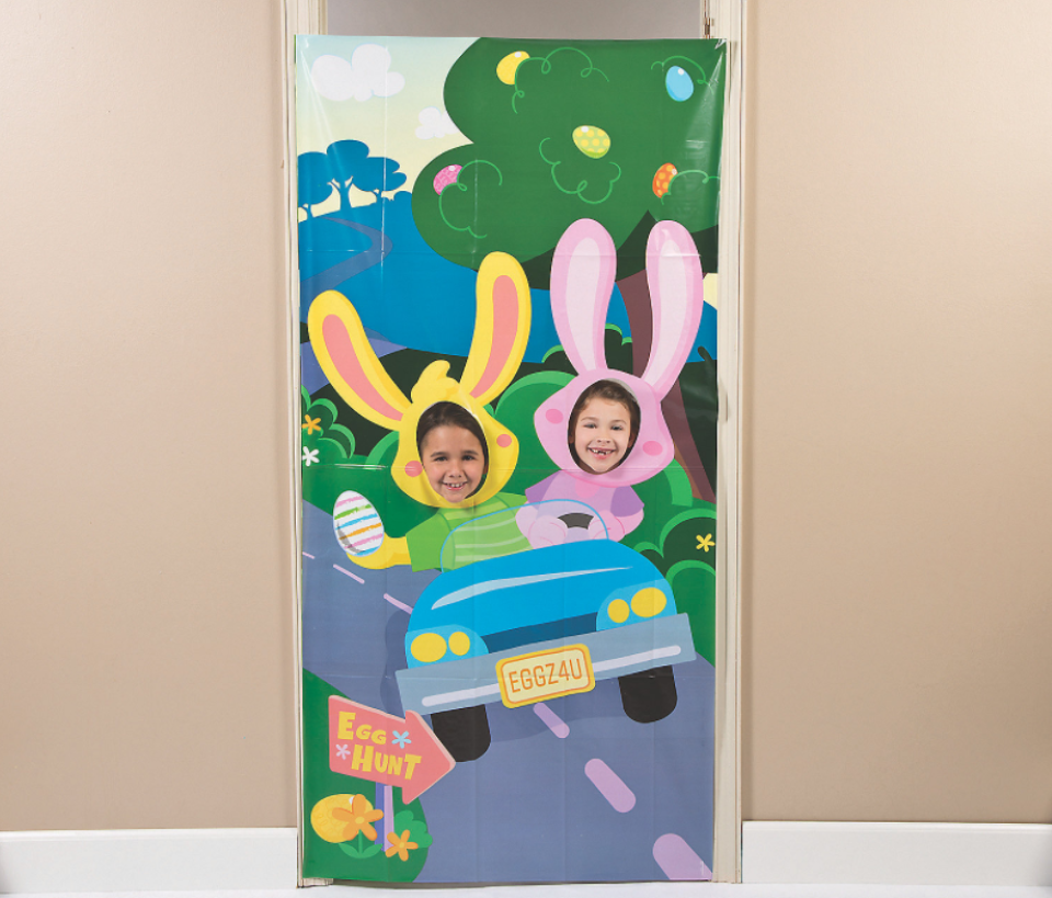 kids with their faces in a bunny picture frame