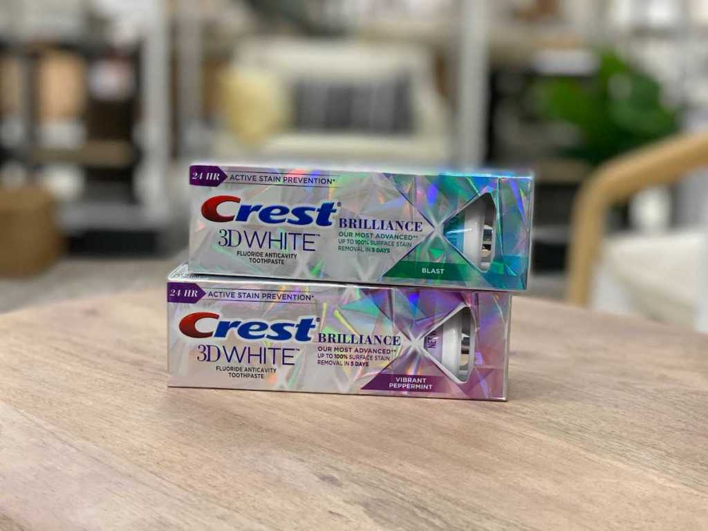 CREST 3d White Brilliance Toothpastes stacked on table