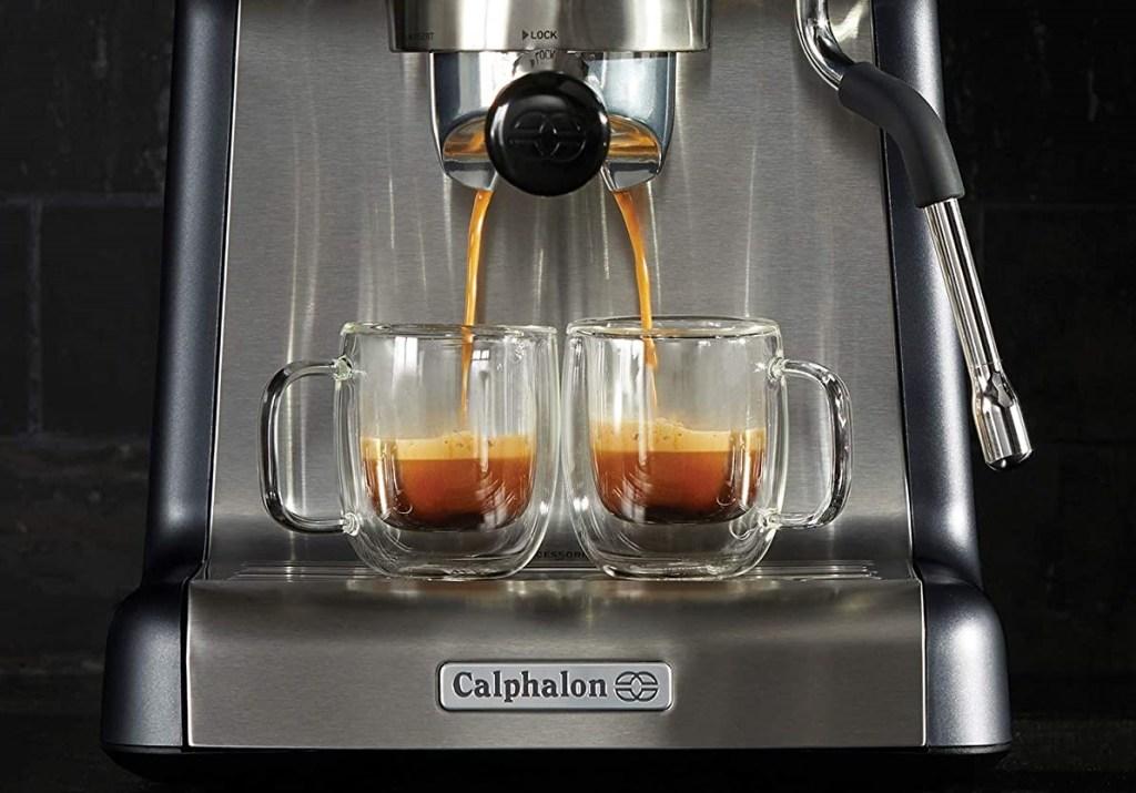 espresso maker with two cups of espresso