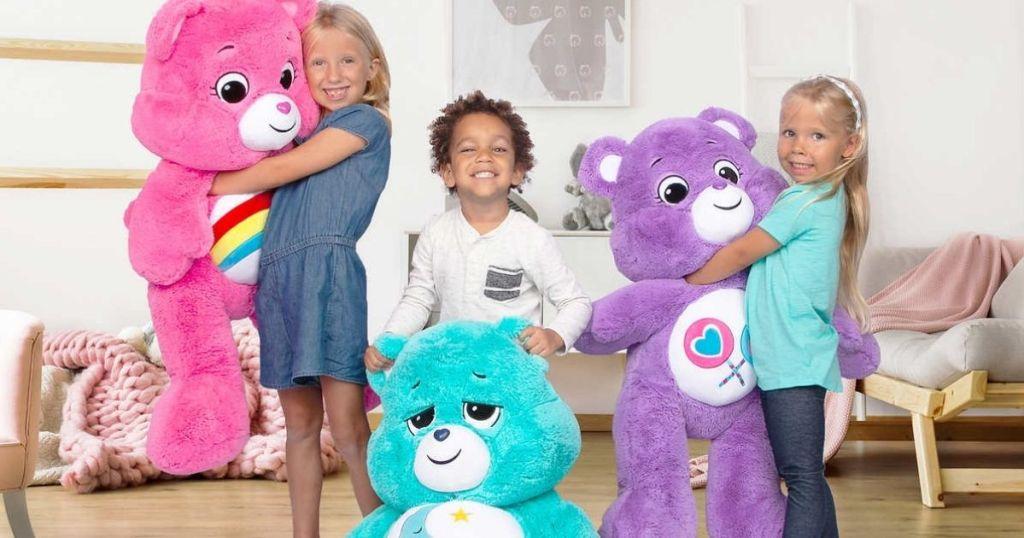 kids holding large Care Bears Plush