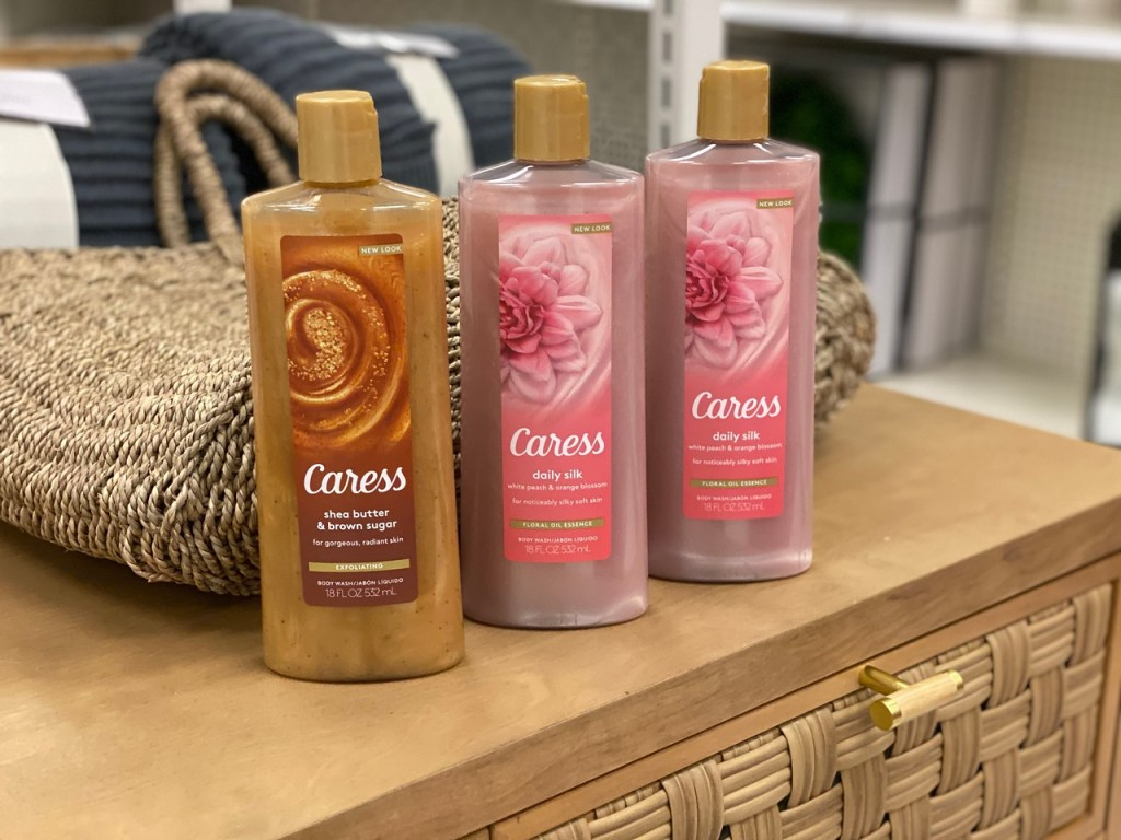 Caress Body Washes on counter in front of basket