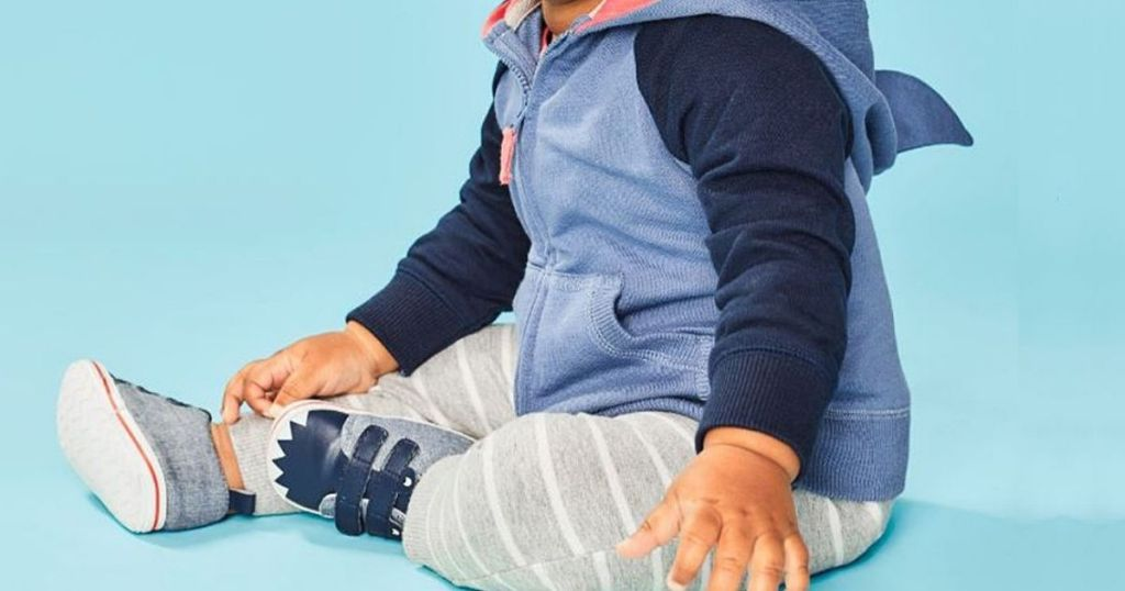 baby wearing Carter's Shark theme outfit