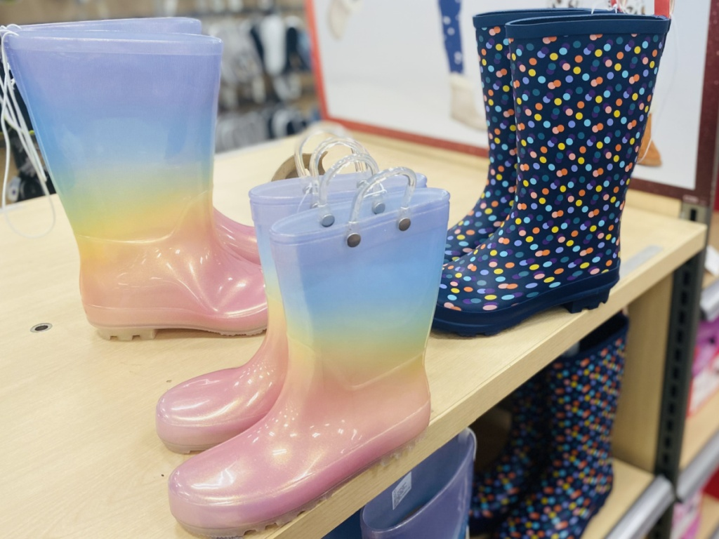 Three styles of kids boots on display in-store