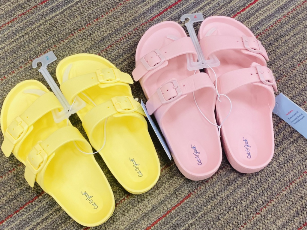 Two pairs of kids sandals on store floor