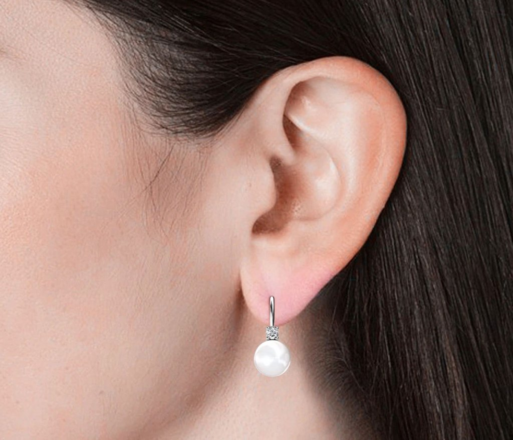 woman wearing cate & Chloe pearl and crystal earring