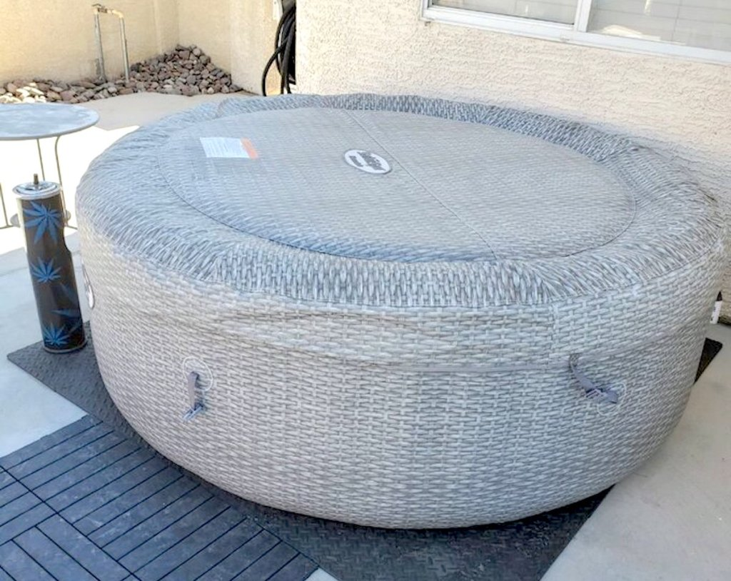 close up of gray inflatable hot tub on outside patio