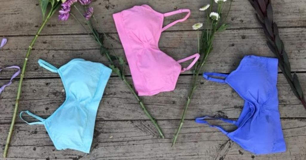 three bras with flowers by them