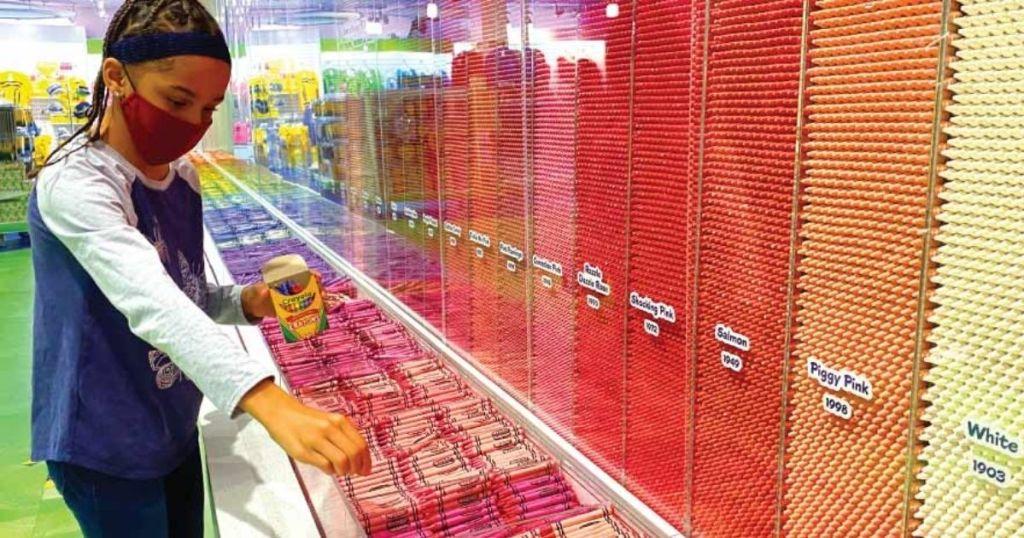 Child choosing crayons at Crayola Experience FREE Crayons