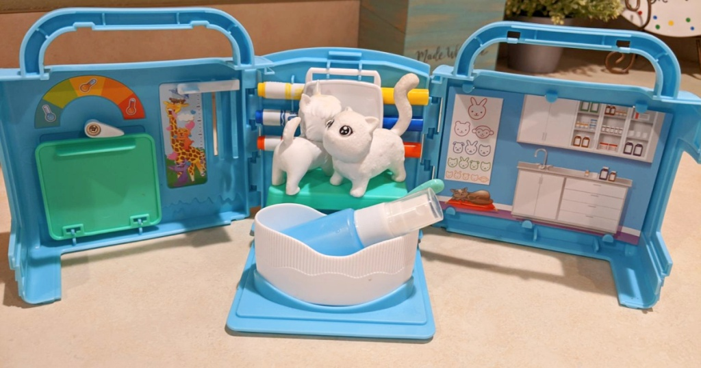 vet playset with two toy cats on table