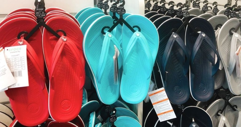 Crocs Crocband Flips hanging up in store
