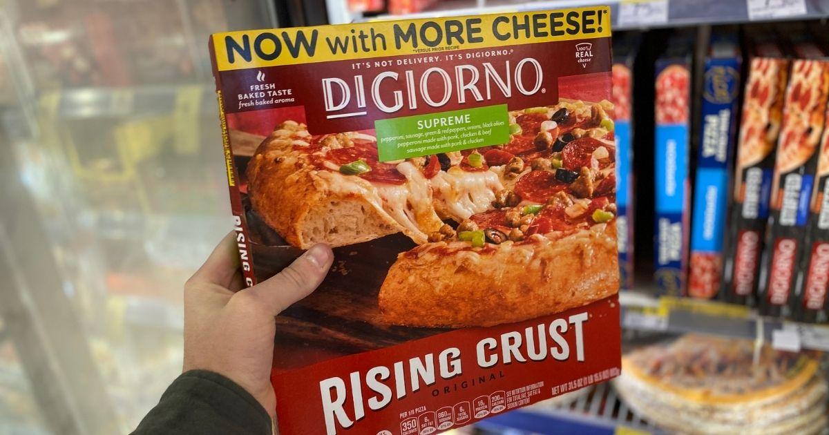 hand holding a DiGiorno pizza