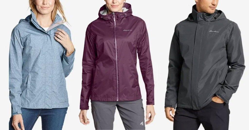 three men and women modeling rain jackets