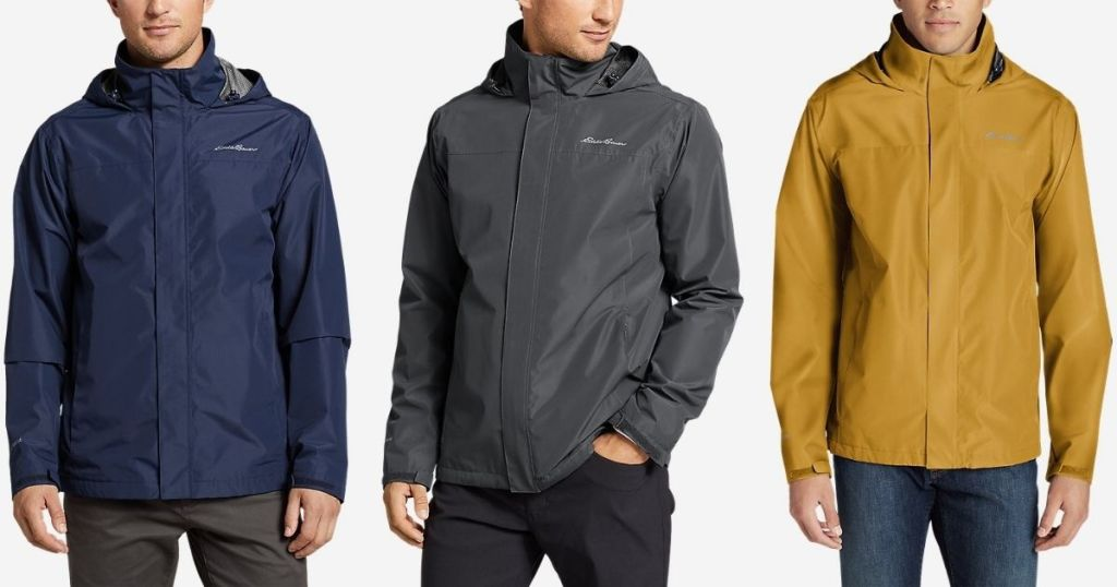 three men wearing jackets
