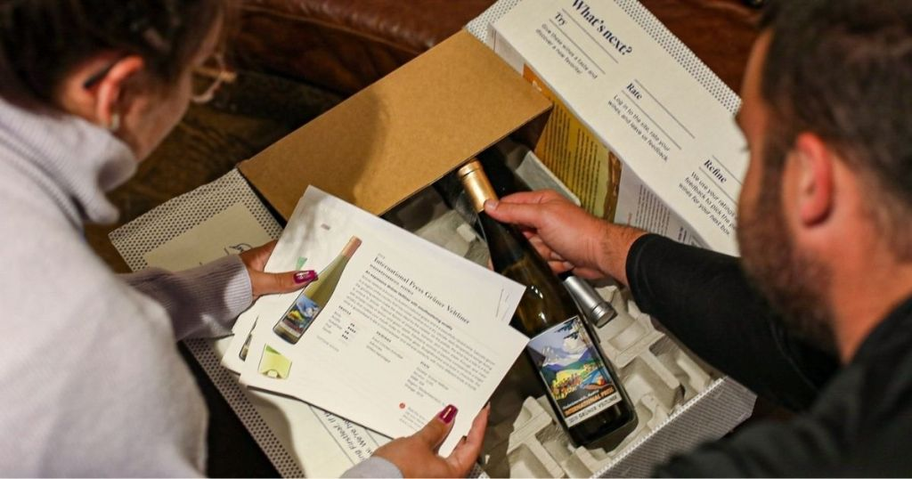 couple opening box of Firstleaf wines