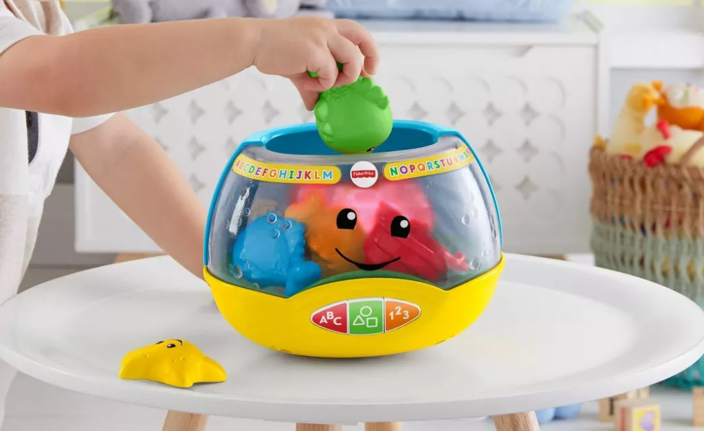 child playing with a toy fishbowl
