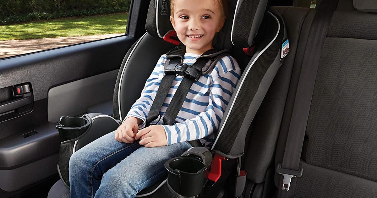 girl in car seat in car