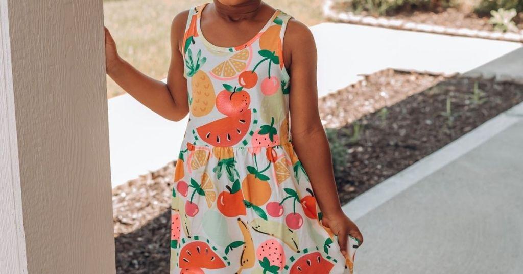 girl wearing a sleeveless dress