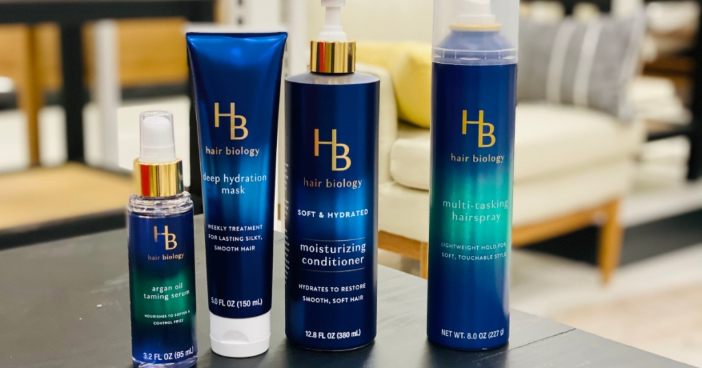 four blue bottles of hair products