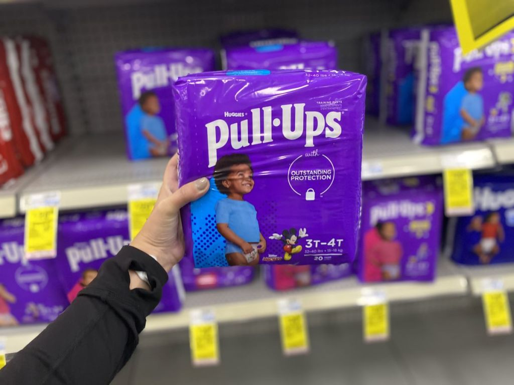 hand holding a package of Huggies Pull-Ups