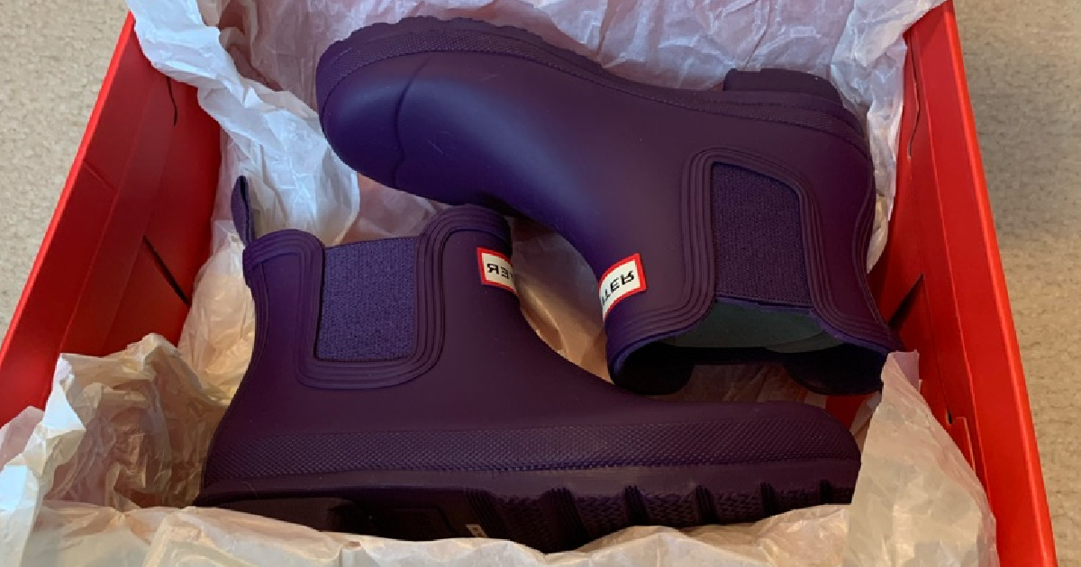 a pair of purple Hunter womens boots in a box with tissue paper