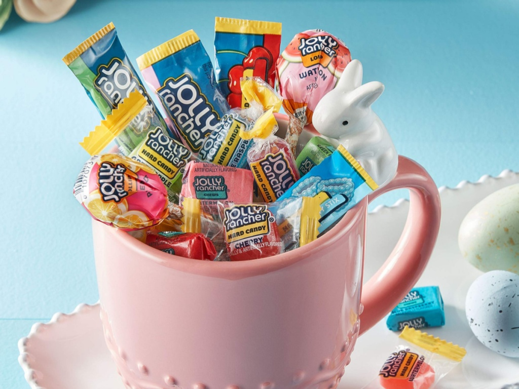 light pink cup filled with jolly rancher candies