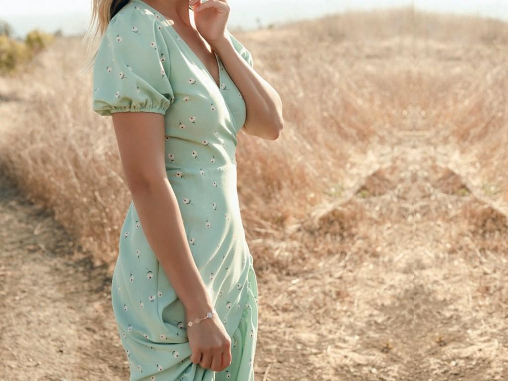 woman wearing green flowery dress in field