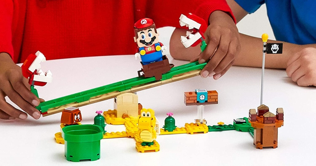 kids playing with LEGO super mario pirhana