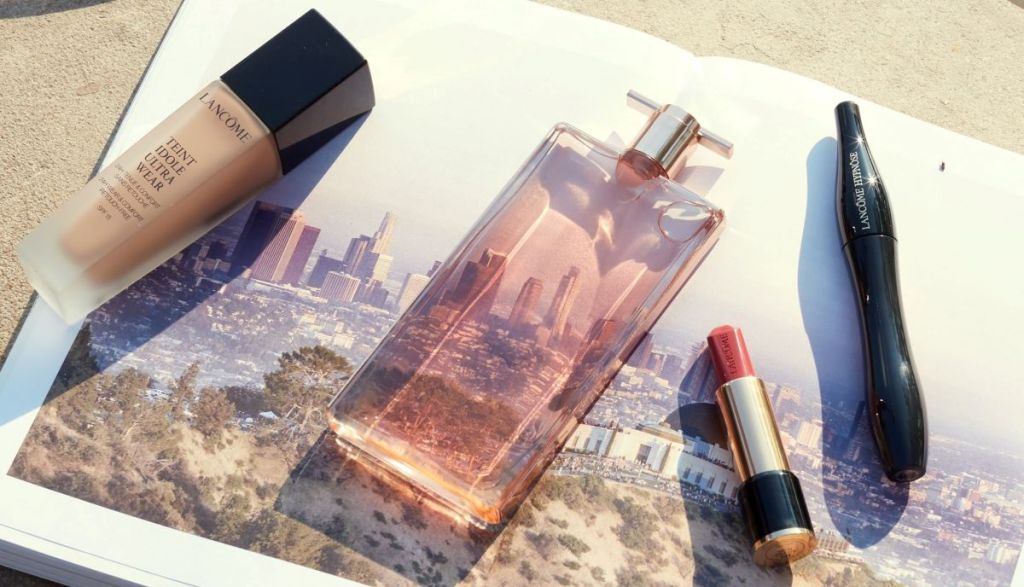 Lancome products sitting on an open book