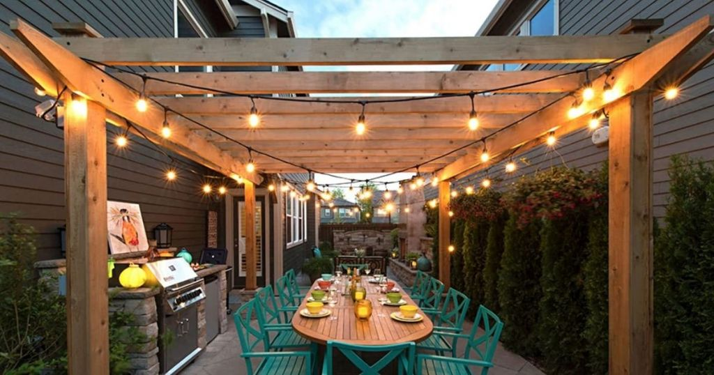 Lemontec Outdoor String Lights in a pergola with outdoor dinner setup