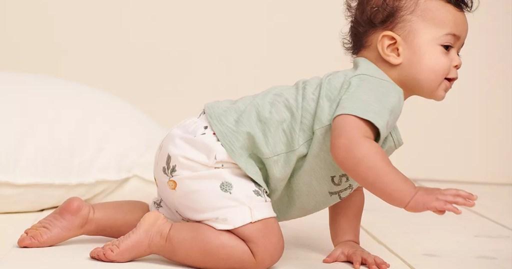 baby boy crawling on floor in shorts and tshirt
