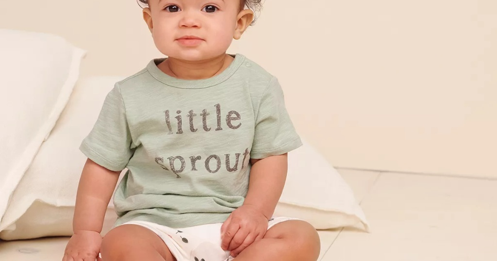 baby boy in green graphic tee