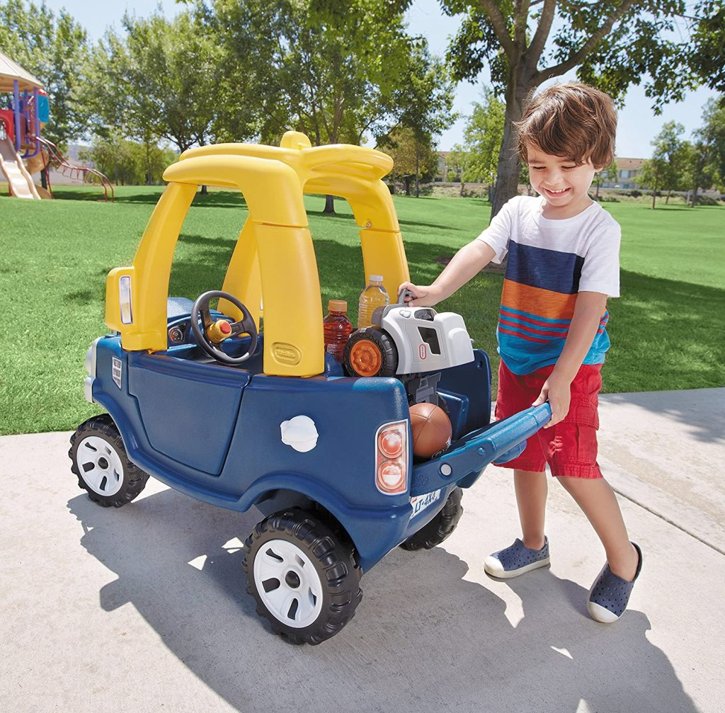 boy loading up back of Little Tikes Cozy Truck