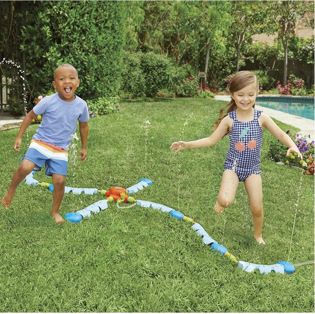 Kids playing in Little Tikes Sprinkler