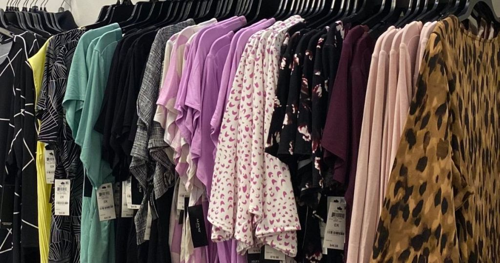 women's shirts on hangers at a store
