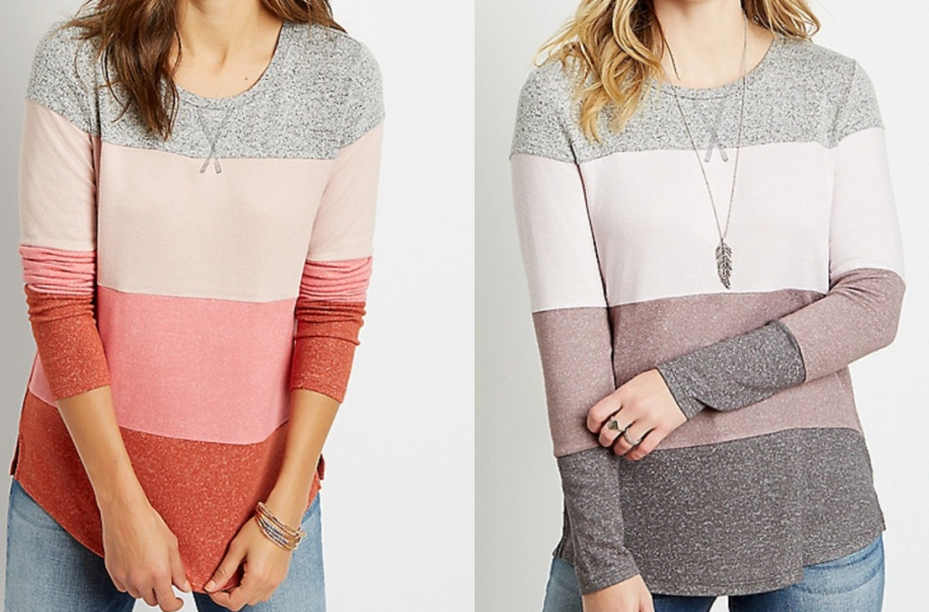 2 women wearing colorblock long sleeve tops